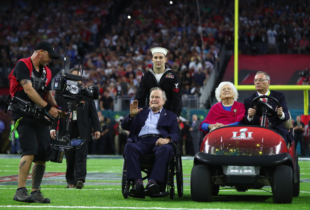 . HOUSTON, TX - FEBRUARY 05:  President George H.W. Bush and Barbara Bush arrives for the coin toss prior to Super Bowl 51 between the Atlanta Falcons and the New England Patriots at NRG Stadium on February 5, 2017 in Houston, Texas.  (Photo by Al Bello/Getty Images)