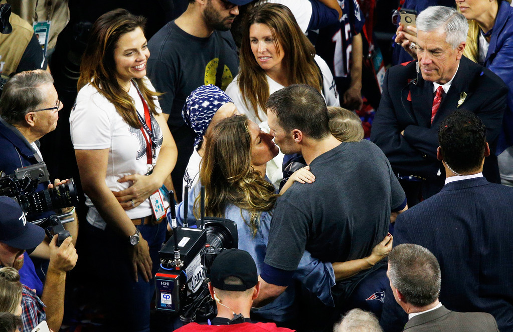 . HOUSTON, TX - FEBRUARY 05:  Gisele Bündchen and Tom Brady #12 of the New England Patriots celebrate after defeating the Atlanta Falcons 34-28 in overtime during Super Bowl 51 at NRG Stadium on February 5, 2017 in Houston, Texas.  (Photo by Bob Levey/Getty Images)