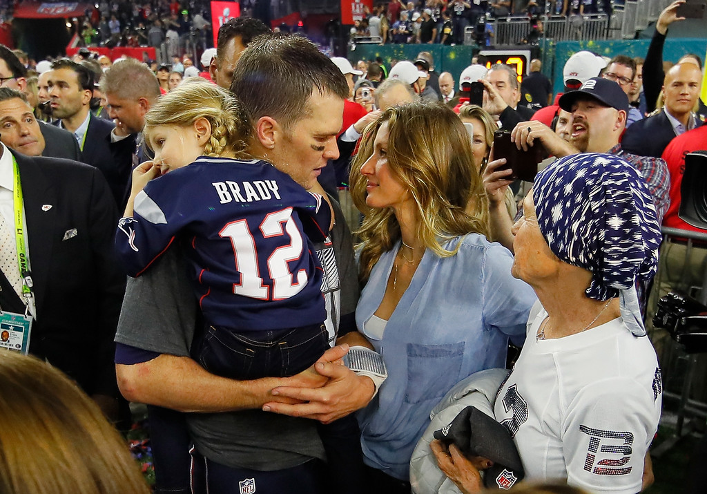 . HOUSTON, TX - FEBRUARY 05:  Tom Brady #12 of the New England Patriots celebrates with wife Gisele Bundchen and daughter Vivian Brady after defeating the Atlanta Falcons during Super Bowl 51 at NRG Stadium on February 5, 2017 in Houston, Texas. The Patriots defeated the Falcons 34-28.  (Photo by Kevin C. Cox/Getty Images)