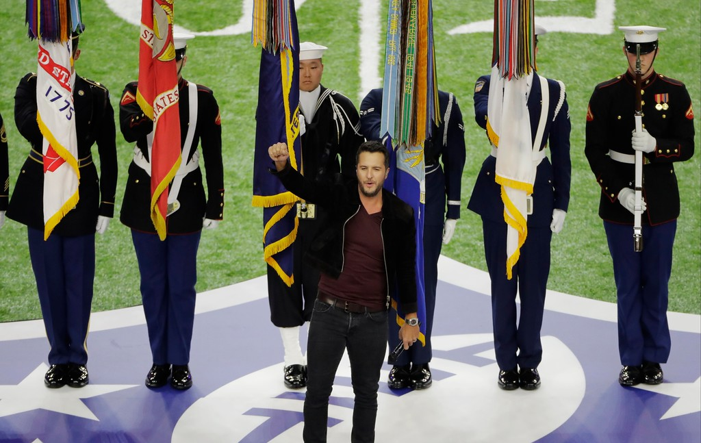 . Country music artist Luke Bryan sings the national anthem before the NFL Super Bowl 51 football game between the Atlanta Falcons and the New England Patriots, Sunday, Feb. 5, 2017, in Houston. (AP Photo/Charlie Riedel)
