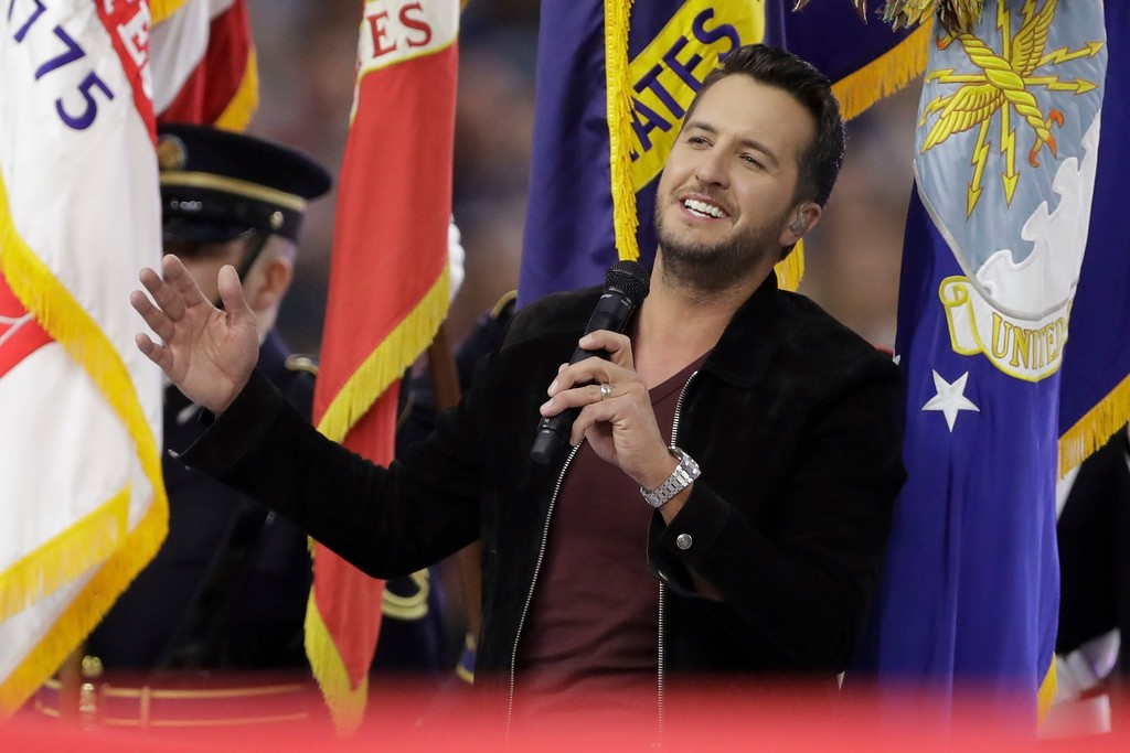 . Country music singer Luke Bryan sings the National Anthem, before the NFL Super Bowl 51 football game between the New England Patriots and the Atlanta Falcons, Sunday, Feb. 5, 2017, in Houston. (AP Photo/Darron Cummings)
