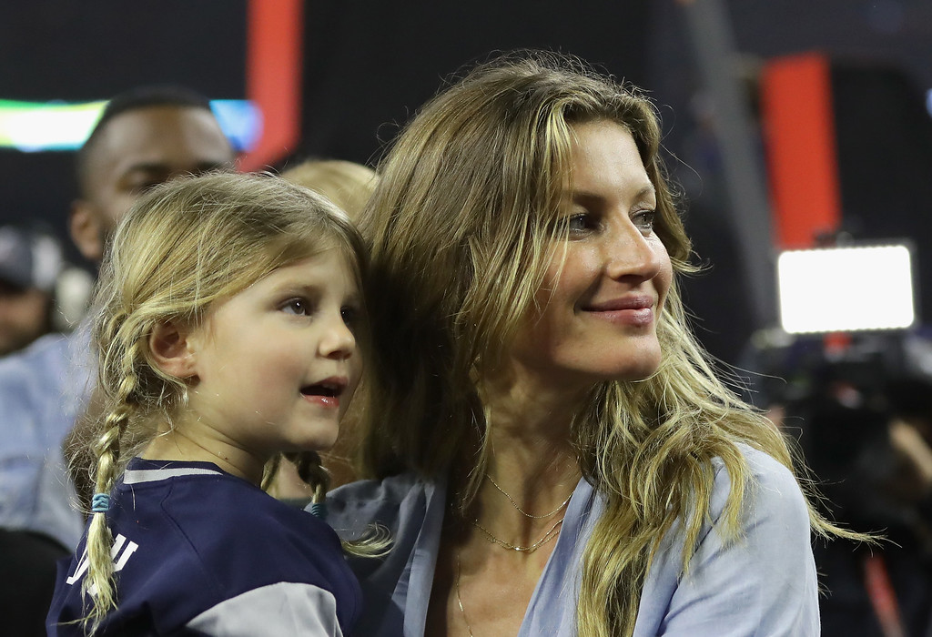 . HOUSTON, TX - FEBRUARY 05:  Gisele Bundchen celebrates with daughter Vivian Brady after the New England Patriots defeated the Atlanta Falcons during Super Bowl 51 at NRG Stadium on February 5, 2017 in Houston, Texas.  The Patriots defeated the Falcons 34-28.  (Photo by Ronald Martinez/Getty Images)