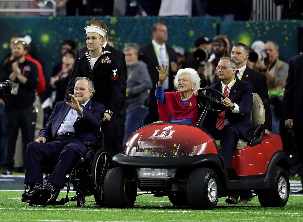 . Former President George H.W. Bush and wife, Barbara, wave as they arrive on the field for a coin toss before the NFL Super Bowl 51 football game between the Atlanta Falcons and the New England Patriots Sunday, Feb. 5, 2017, in Houston. (AP Photo/Eric Gay)