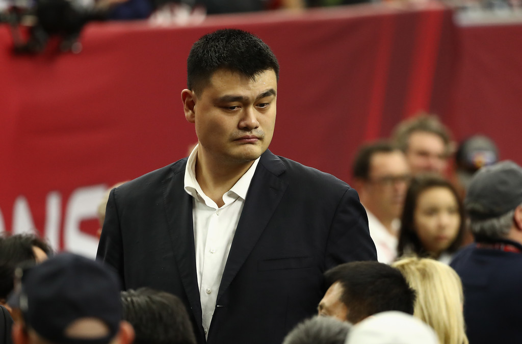 . HOUSTON, TX - FEBRUARY 05: Former Houston Rocket and NBA Hall of Famer Yao Ming walks on the sideline before Super Bowl 51 between the Atlanta Falcons and the New England Patriots at NRG Stadium on February 5, 2017 in Houston, Texas.  (Photo by Elsa/Getty Images)