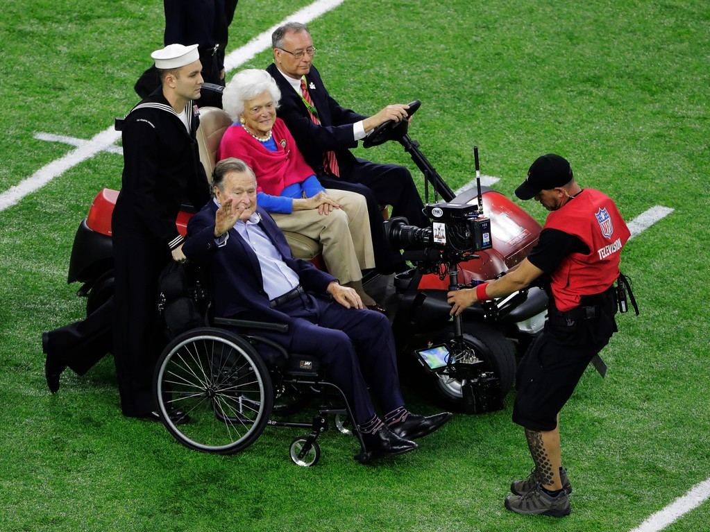 . Former President George H.W. Bush and wife, Barbara arrive on the field before the NFL Super Bowl 51 football game between the New England Patriots and the Atlanta Falcons, Sunday, Feb. 5, 2017, in Houston. (AP Photo/Charlie Riedel)