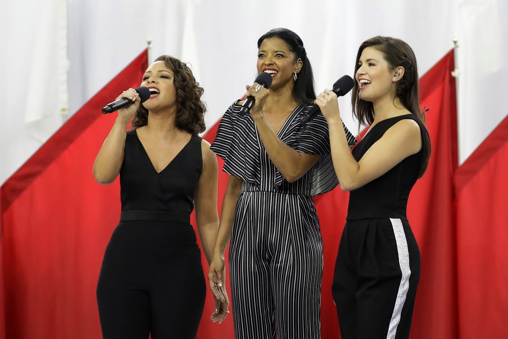 ". Singers of the cast of Hamilton, Phillipa Soo, right, Rene Elise Goldsberry, center, and Jasmine Cephas Jones, sing ""God Bless America\"", before the NFL Super Bowl 51 football game between the New England Patriots and the Atlanta Falcons, Sunday, Feb. 5, 2017, in Houston. (AP Photo/Patrick Semansky)"