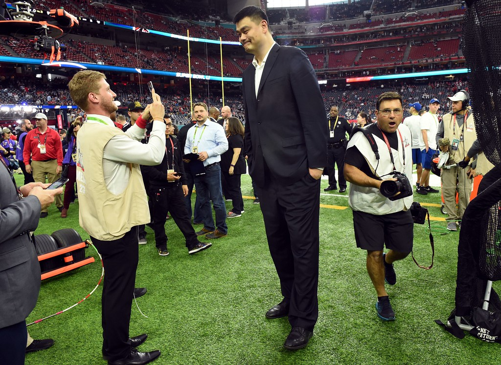 . Former NBA player Yao Ming (C) arrives for Super Bowl LI between the New England Patriots and the Atlanta Falcons at NGR Stadium in Houston, Texas, on February 5, 2017. (TIMOTHY A. CLARY/AFP/Getty Images)