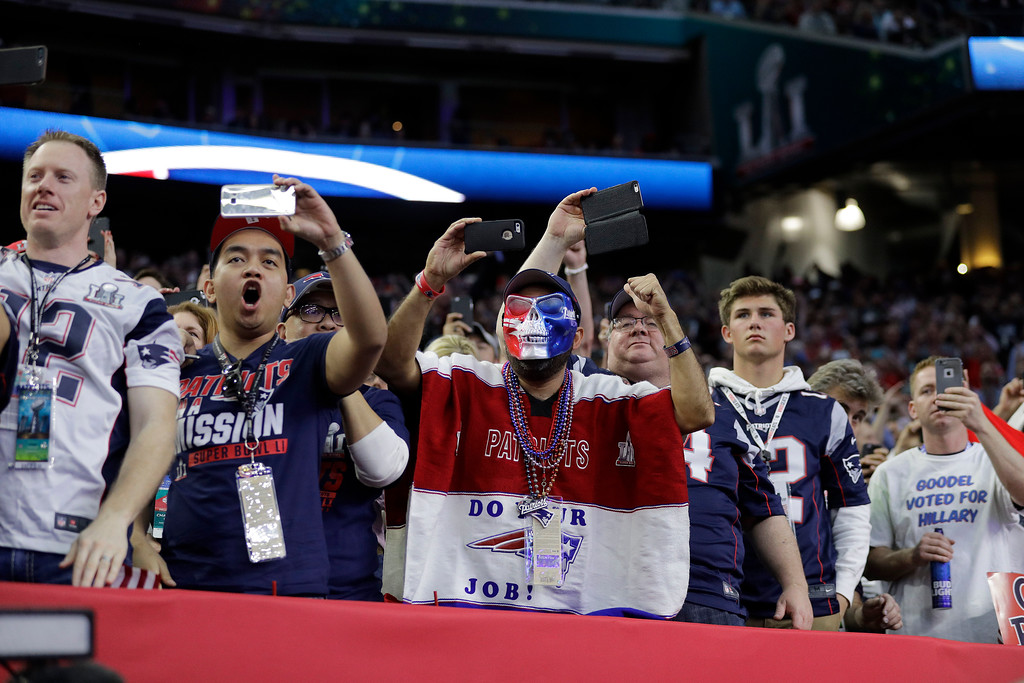 . New England Patriots fans cheer before the NFL Super Bowl 51 football game between the Atlanta Falcons and the New England Patriots Sunday, Feb. 5, 2017, in Houston. (AP Photo/Jae C. Hong)