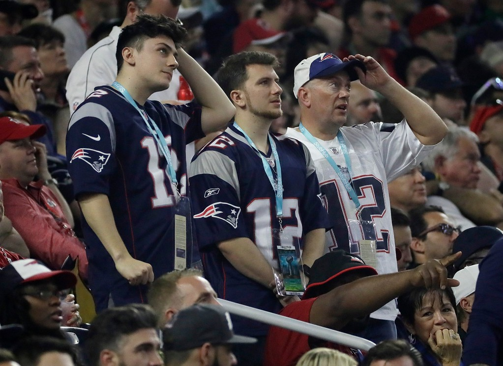 . New England Patriots fans react during the second half of the NFL Super Bowl 51 football game between the Atlanta Falcons and the New England Patriots Sunday, Feb. 5, 2017, in Houston. (AP Photo/Mark Humphrey)