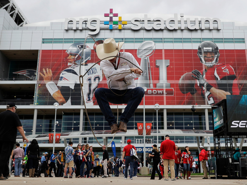 . Joe Ward performs outside NRG Stadium before the NFL Super Bowl 51 football game between the New England Patriots and the Atlanta Falcons, Sunday, Feb. 5, 2017, in Houston. (AP Photo/Eric Gay)