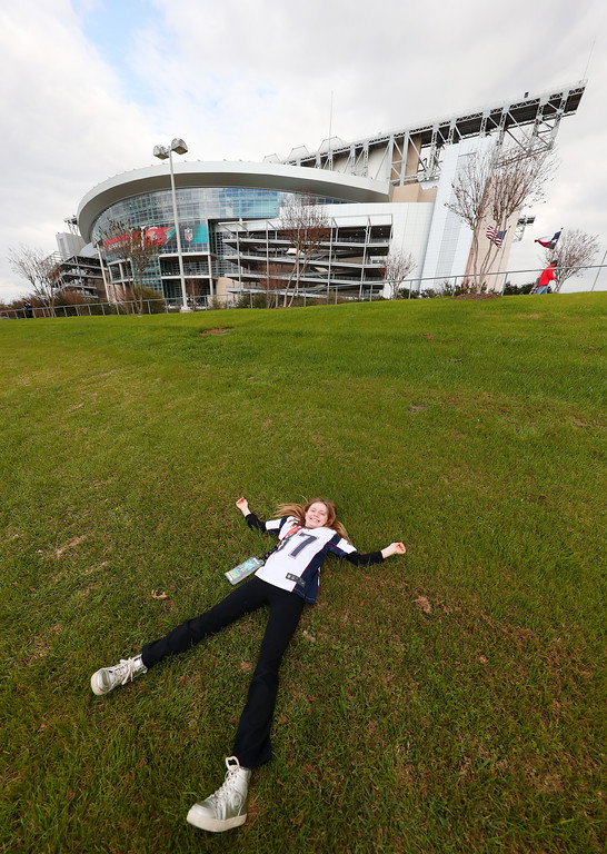 . HOUSTON, TX - FEBRUARY 05:  A young New England Patriots fan lies on grass prior to Super Bowl 51 between the New England Patriots and the Atlanta Falcons at NRG Stadium on February 5, 2017 in Houston, Texas.  (Photo by Tom Pennington/Getty Images)