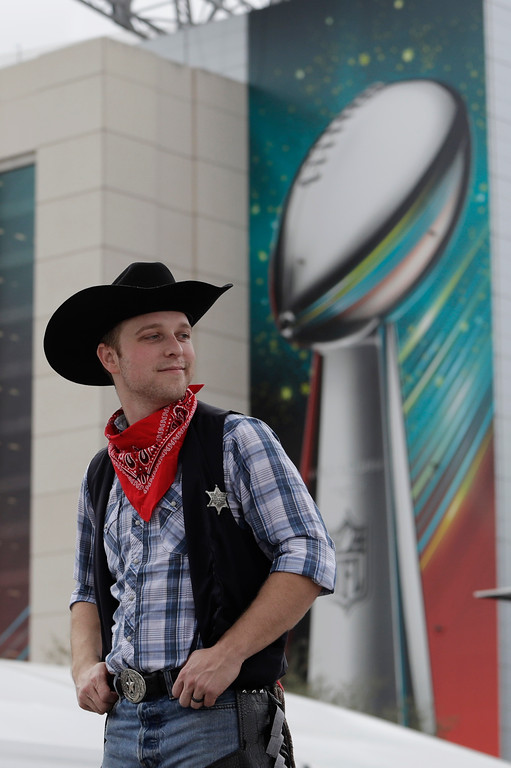 . A fan stands outside NRG Stadium before the NFL Super Bowl 51 football game between the New England Patriots and the Atlanta Falcons, Sunday, Feb. 5, 2017, in Houston. (AP Photo/Eric Gay)