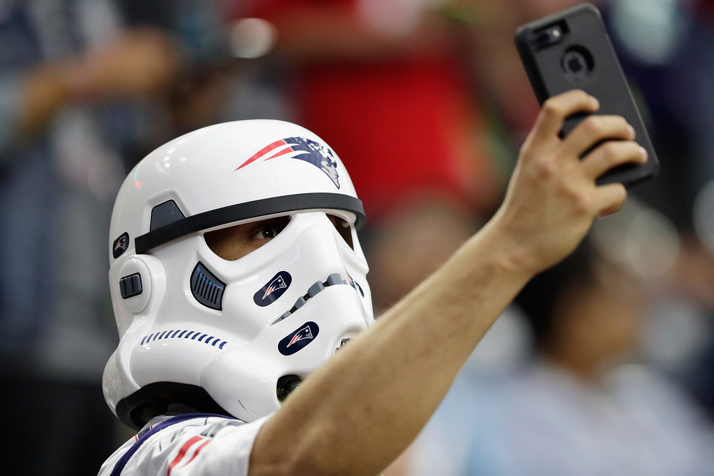 . HOUSTON, TX - FEBRUARY 05:  A New England Patriots fan takes a selfie prior to Super Bowl 51 between the New England Patriots and the Atlanta Falcons at NRG Stadium on February 5, 2017 in Houston, Texas.  (Photo by Jamie Squire/Getty Images)