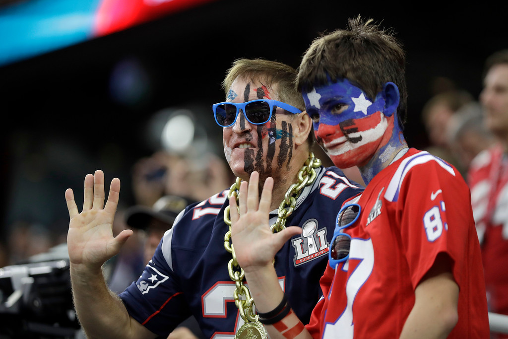 . New England Patriots fans watch before the NFL Super Bowl 51 football game between the Atlanta Falcons and the New England Patriots Sunday, Feb. 5, 2017, in Houston. (AP Photo/Chuck Burton)