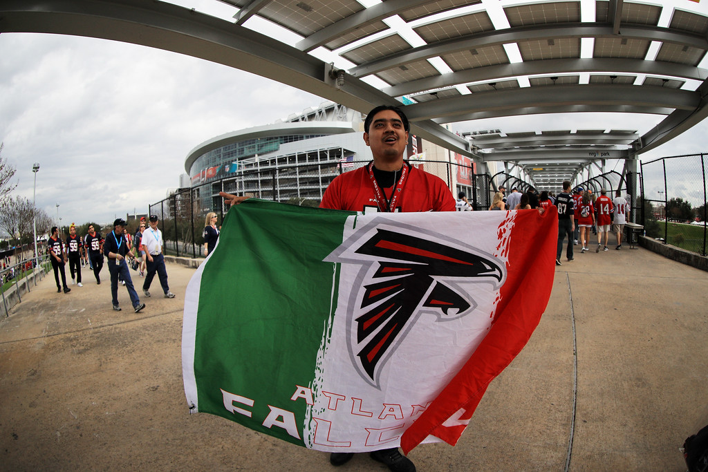 . HOUSTON, TX - FEBRUARY 05:  An Atlanta Falcons fan poses prior to Super Bowl 51 between the New England Patriots and the Atlanta Falcons at NRG Stadium on February 5, 2017 in Houston, Texas.  (Photo by Mike Ehrmann/Getty Images)