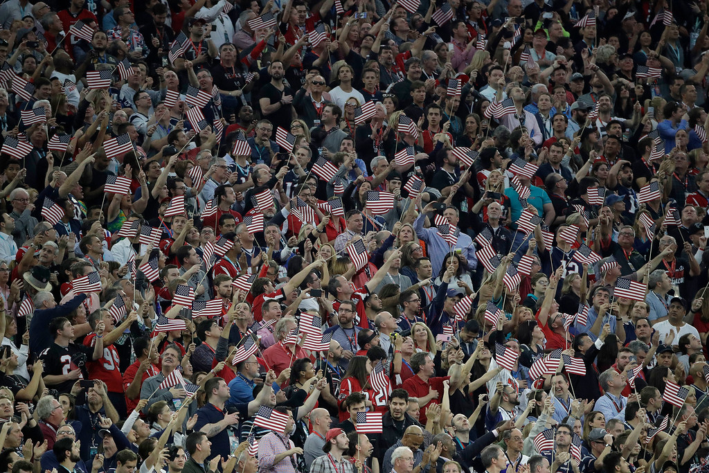 . Fans cheer during the national anthem before the NFL Super Bowl 51 football game between the Atlanta Falcons and the New England Patriots Sunday, Feb. 5, 2017, in Houston. (AP Photo/Jae C. Hong)