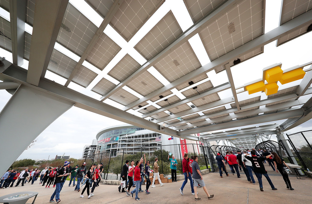 . HOUSTON, TX - FEBRUARY 05:  Fans walk outside of NRG Stadium prior to Super Bowl 51 between the New England Patriots and the Atlanta Falcons on February 5, 2017 in Houston, Texas.  (Photo by Tom Pennington/Getty Images)