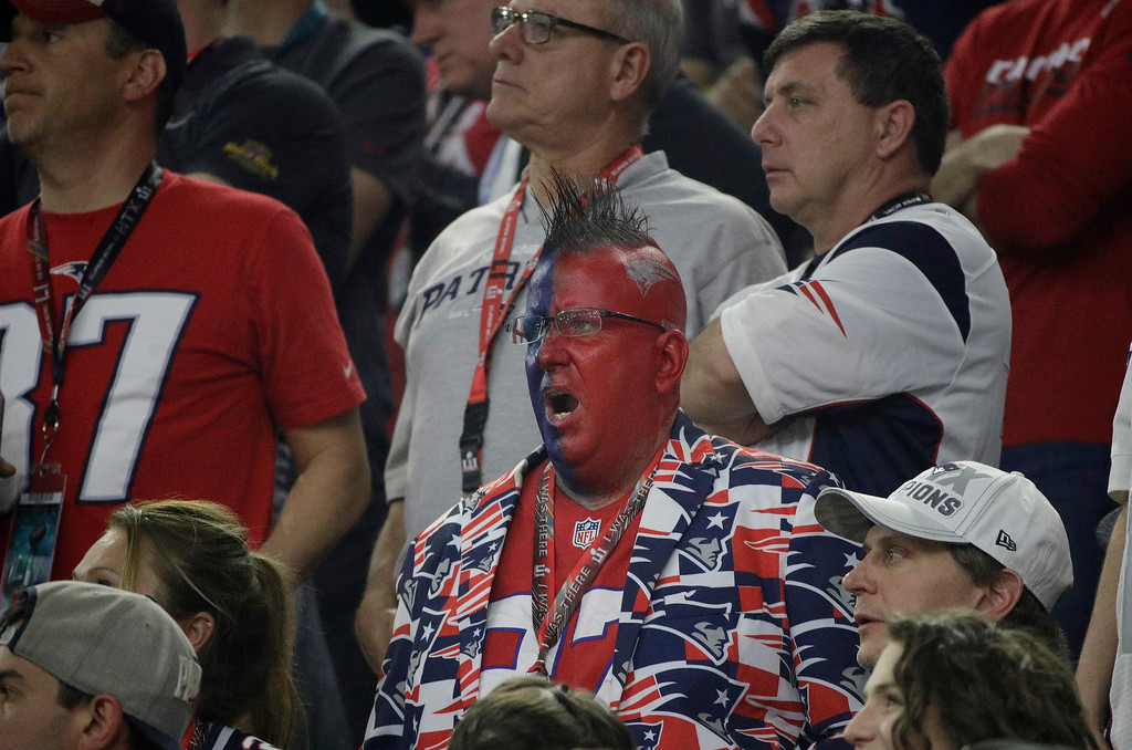 . New England Patriots fans react during the second half of the NFL Super Bowl 51 football game between the Atlanta Falcons and the New England Patriots Sunday, Feb. 5, 2017, in Houston. (AP Photo/Jae C. Hong)