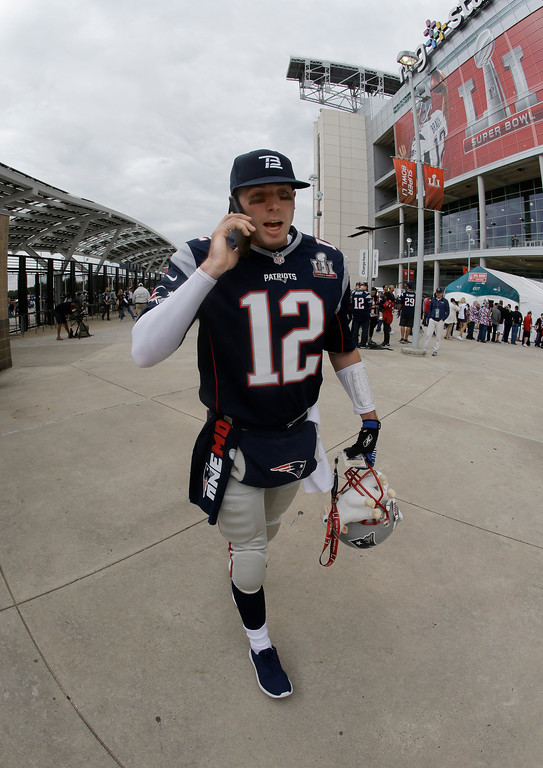 . New England Patriots fan Rob Anderson makes his way to NRG Stadium before the NFL Super Bowl 51 football game against the Atlanta Falcons Sunday, Feb. 5, 2017, in Houston. (AP Photo/Mark Humphrey)