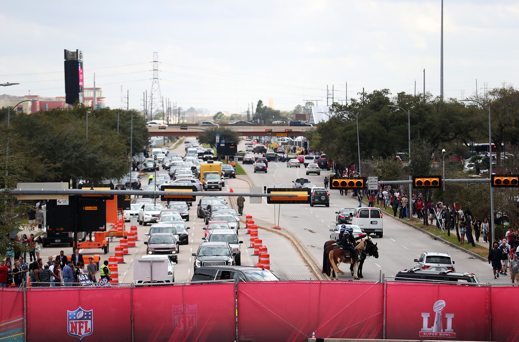 . HOUSTON, TX - FEBRUARY 05:  Cars and security are seen lined up outside on the stree during Super Bowl 51 at NRG Stadium on February 5, 2017 in Houston, Texas.  (Photo by Tom Pennington/Getty Images)
