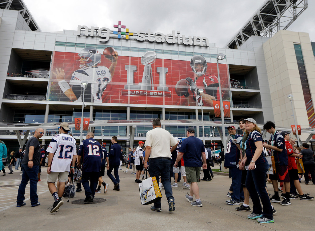 . Fans make their way to NRG Stadium before the NFL Super Bowl 51 football game between the New England Patriots and the Atlanta Falcons Sunday, Feb. 5, 2017, in Houston. (AP Photo/Mark Humphrey)