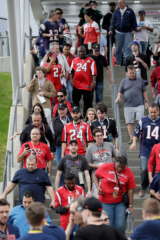 . Fans arrive at the stadium before the NFL Super Bowl 51 football game between the Atlanta Falcons and the New England Patriots, Sunday, Feb. 5, 2017, in Houston. (AP Photo/Mark Humphrey)