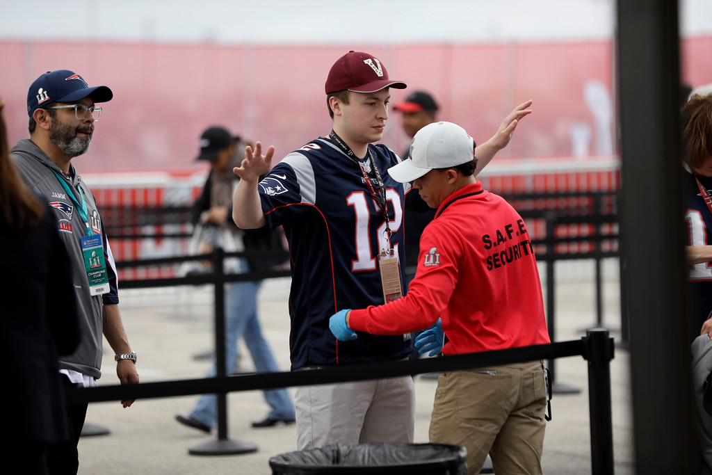 . Fans are checked at a security checkpoint before the NFL Super Bowl 51 football game between the Atlanta Falcons and New England Patriots, Sunday, Feb. 5, 2017, in Houston. (AP Photo/Mark Humphrey)