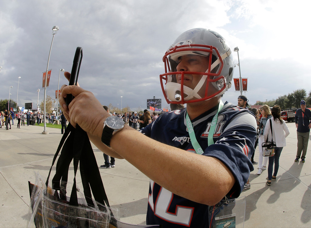 . Guillermo Morcera takes a picture outside NRG Stadium before the NFL Super Bowl 51 football game between the New England Patriots and the Atlanta Falcons Sunday, Feb. 5, 2017, in Houston. (AP Photo/Mark Humphrey)