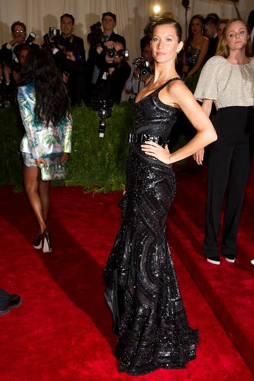. Gisele Bundchen arrives at the Metropolitan Museum of Art Costume Institute gala benefit, celebrating Elsa Schiaparelli and Miuccia Prada, Monday, May 7, 2012 in New York. (AP Photo/Charles Sykes)