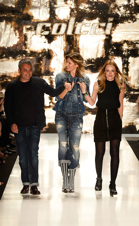 . Jeziel Moraes, Gisele Bündchen and Adriana Zucco walk the runway after the Colcci fashion show during Sao Paulo Fashion Week Winter 2015 at Parque Candido Portinari on November 4, 2014 in Sao Paulo, Brazil.  (Photo by Studio Fernanda Calfat/Getty Images)