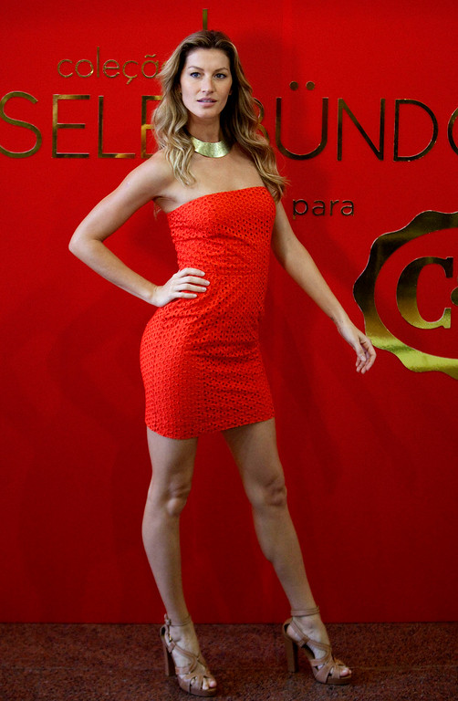 . Brazilian top model Gisele Bundchen poses for pictures as she wears a design by C&A from a collection with her name at a promotional event in Sao Paulo, Brazil, Thursday Dec. 1, 2011. (AP Photo/Andre Penner)