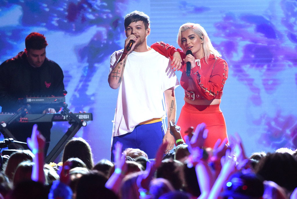 . Louis Tomlinson, left, and Bebe Rexha perform at the Teen Choice Awards at the Galen Center on Sunday, Aug. 13, 2017, in Los Angeles. (Photo by Phil McCarten/Invision/AP)