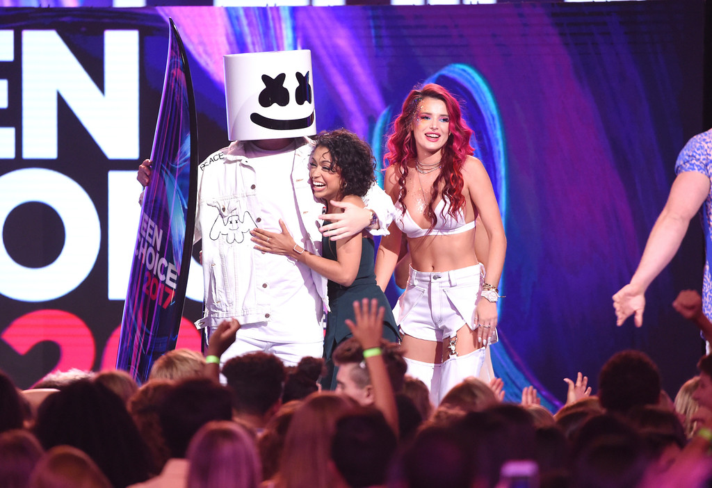 . Marshmello, left and Bella Thorne, right, present the award for choice female web star to Liza Koshy at the Teen Choice Awards at the Galen Center on Sunday, Aug. 13, 2017, in Los Angeles. (Photo by Phil McCarten/Invision/AP)