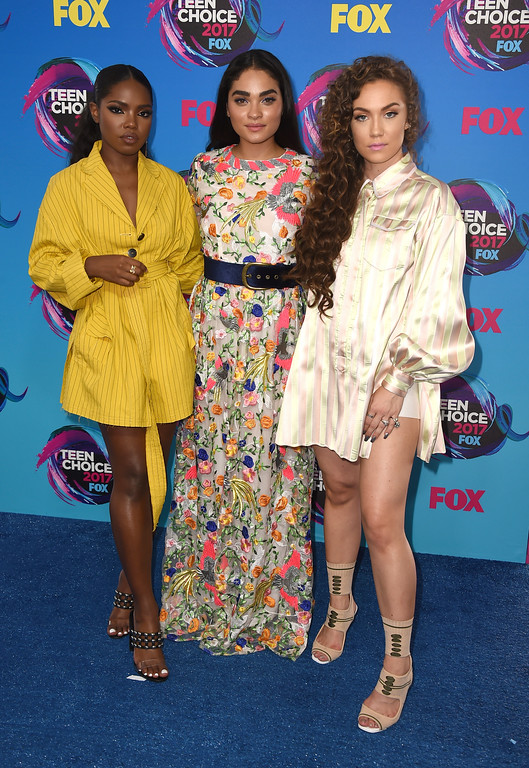 . Ryan Destiny, from left, Brittany O\'Grady and Jude Demorest arrive at the Teen Choice Awards at the Galen Center on Sunday, Aug. 13, 2017, in Los Angeles. (Photo by Jordan Strauss/Invision/AP)