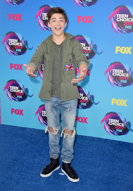 . Asher Angel arrives at the Teen Choice Awards at the Galen Center on Sunday, Aug. 13, 2017, in Los Angeles. (Photo by Jordan Strauss/Invision/AP)