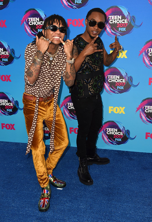 ". Slim Jxmmi, left and Swae Lee of ""Rae Sremmurd\"" arrive at the Teen Choice Awards at the Galen Center on Sunday, Aug. 13, 2017, in Los Angeles. (Photo by Jordan Strauss/Invision/AP)"