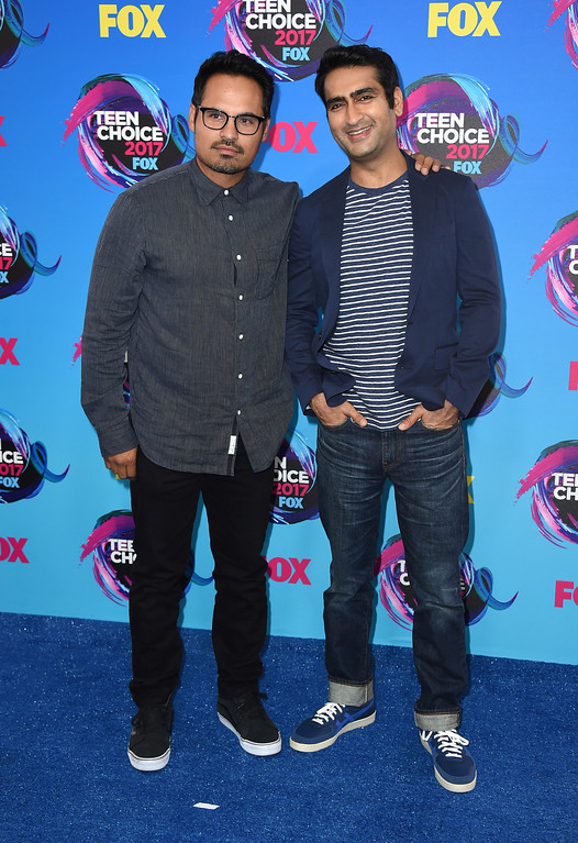 . Michael Pena, left, and Kumail Nanjiani arrive at the Teen Choice Awards at the Galen Center on Sunday, Aug. 13, 2017, in Los Angeles. (Photo by Jordan Strauss/Invision/AP)