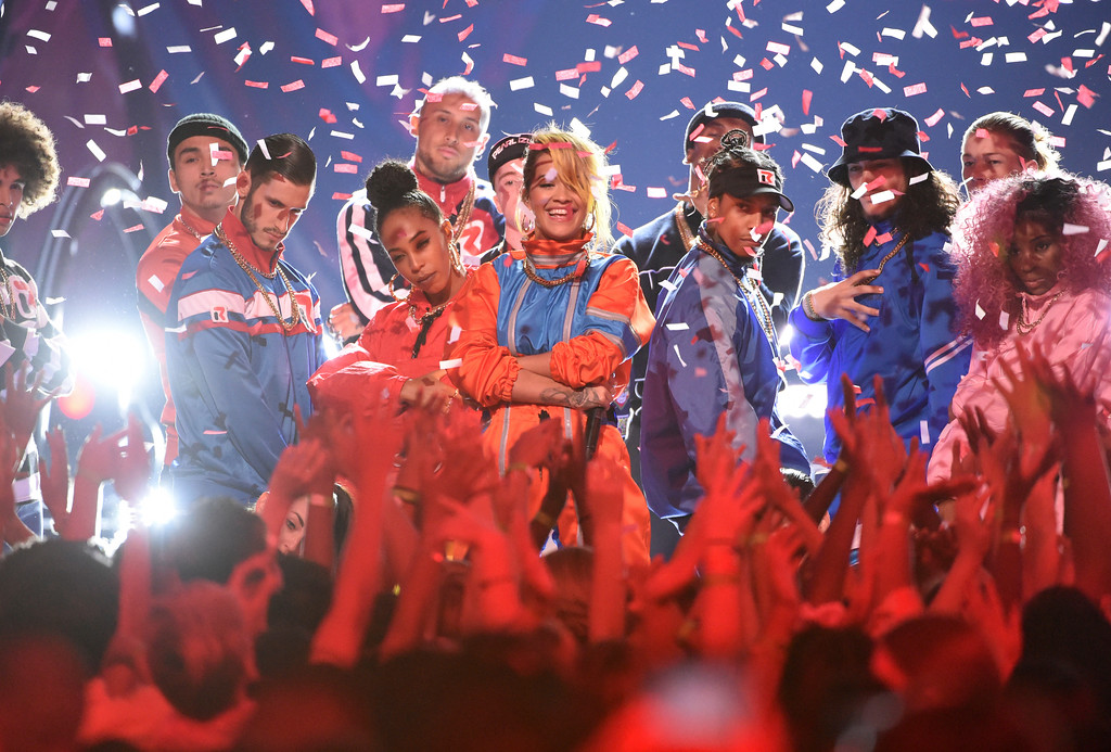 . Rita Ora, center, performs at the Teen Choice Awards at the Galen Center on Sunday, Aug. 13, 2017, in Los Angeles. (Photo by Phil McCarten/Invision/AP)