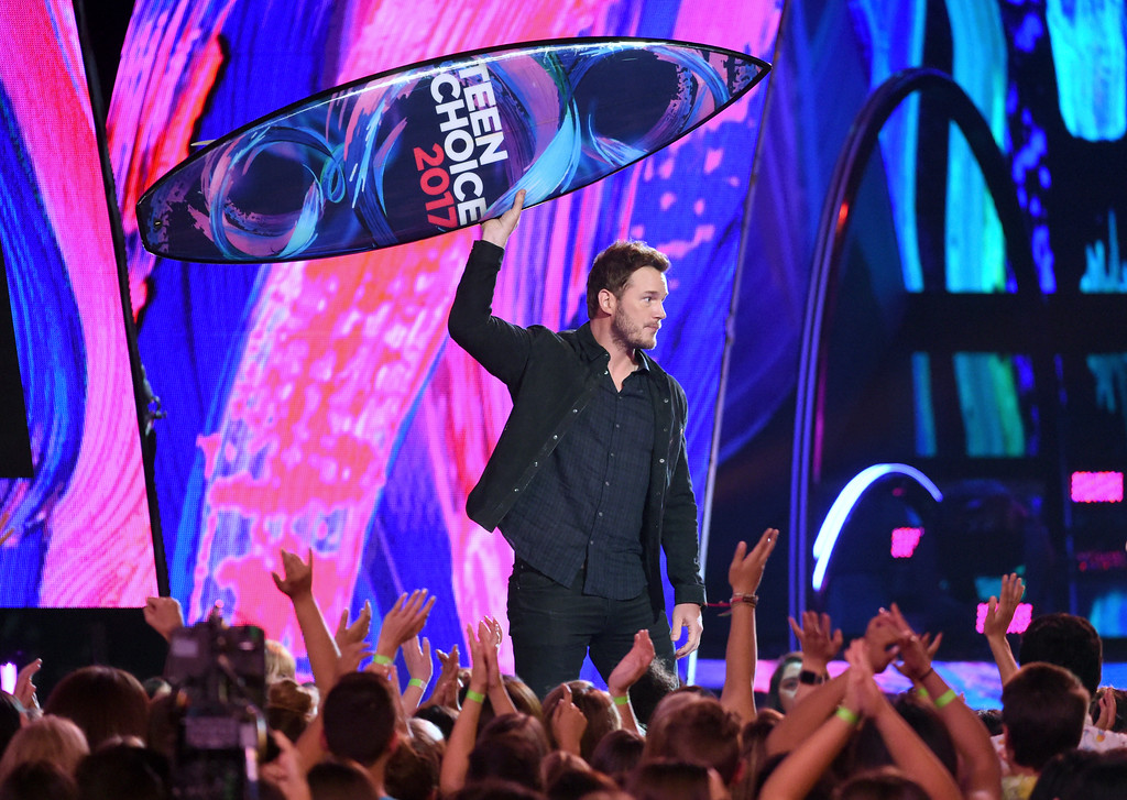 ". Chris Pratt accepts the award for choice sci-fi movie actor for ""Guardians of the Galaxy Vol. 2\"" at the Teen Choice Awards at the Galen Center on Sunday, Aug. 13, 2017, in Los Angeles. (Photo by Phil McCarten/Invision/AP)"