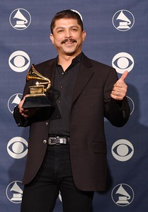 Winner for Best Tejano Album for 'Acuerdate', Emilio Navaira poses backstage at the 45th Annual Grammy Awards Pre-Telecast at Madison Square Garden on February 23, 2003 in New York City. (Photo by Mark Mainz/Getty Images)