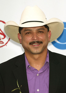 In this Sept. 3, 2003 file photo, Emilio Navaira arrives at the Latin Grammy Awards in Miami. The Grammy-winning Tejano star has died in New Braunfels,  Texas. He was 53. Police in New Braunfels said in a statement Tuesday, May 17, 2016, that preliminary results indicate the entertainer died of natural causes. (AP Photo/Wilfredo Lee, file)