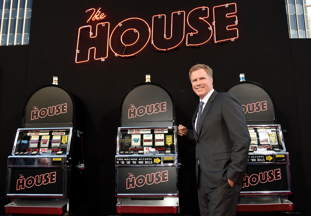 ". Will Ferrell, a cast member in ""The House,\"" poses alongside slot machines on the red carpet at the premiere of the film at the TCL Chinese Theatre on Monday, June 26, 2017, in Los Angeles. (Photo by Chris Pizzello/Invision/AP)"