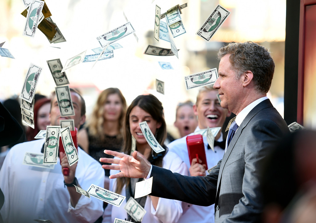 ". Will Ferrell, a cast member in ""The House,\"" throws fake money on the red carpet at the premiere of the film at the TCL Chinese Theatre on Monday, June 26, 2017, in Los Angeles. (Photo by Chris Pizzello/Invision/AP)"