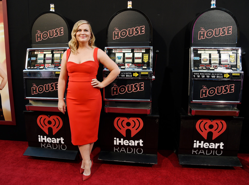 ". Amy Poehler, a cast member in ""The House,\"" poses alongside slot machines on the red carpet at the premiere of the film at the TCL Chinese Theatre on Monday, June 26, 2017, in Los Angeles. (Photo by Chris Pizzello/Invision/AP)"