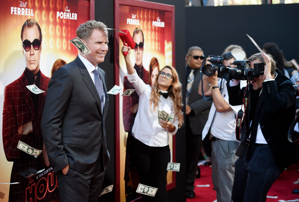 ". Will Ferrell, a cast member in ""The House,\"" poses in the midst of fake money flying through the air at the premiere of the film at the TCL Chinese Theatre on Monday, June 26, 2017, in Los Angeles. (Photo by Chris Pizzello/Invision/AP)"