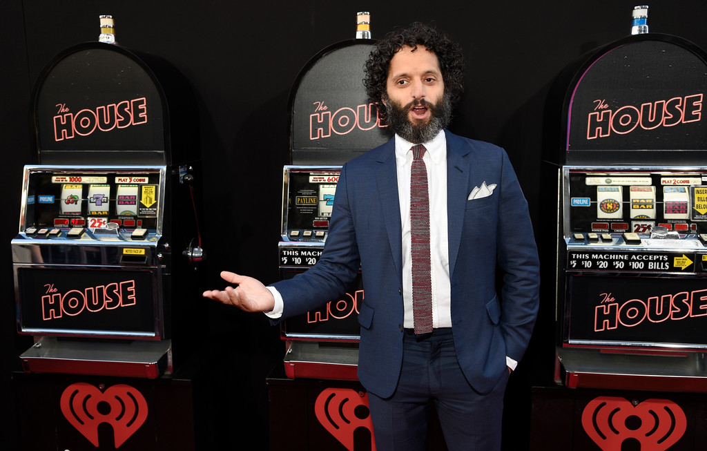 ". Jason Mantzoukas, a cast member in ""The House,\"" poses in front of slot machines set up on the red carpet at the premiere of the film at the TCL Chinese Theatre on Monday, June 26, 2017, in Los Angeles. (Photo by Chris Pizzello/Invision/AP)"