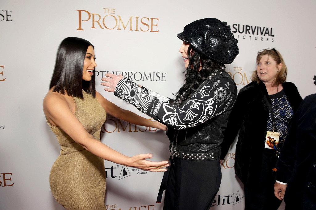 ". Kim Kardashian and Cher seen at Open Road Films US Premiere of ""The Promise\"" at TCL Chinese Theatre on Wednesday, April 12, 2017, in Los Angeles. (Photo by Eric Charbonneau/Invision for Open Road Films/AP Images)"