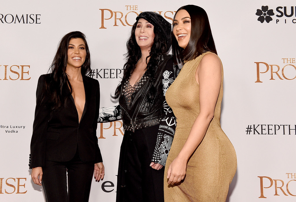 ". HOLLYWOOD, CA - APRIL 12:  TV personality Kourtney Kardashian, singer/actor Cher, and TV personality Kim Kardashian West attend the premiere of Open Road Films\' ""The Promise\"" at TCL Chinese Theatre on April 12, 2017 in Hollywood, California.  (Photo by Kevork Djansezian/Getty Images)"