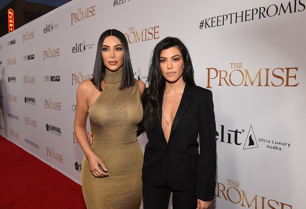""". HOLLYWOOD, CA - APRIL 12:  TV personalities Kim Kardashian West (L) and Kourtney Kardashian attend the premiere of Open Road Films\' \""""The Promise\"""" at TCL Chinese Theatre on April 12, 2017 in Hollywood, California.  (Photo by Kevork Djansezian/Getty Images)"""