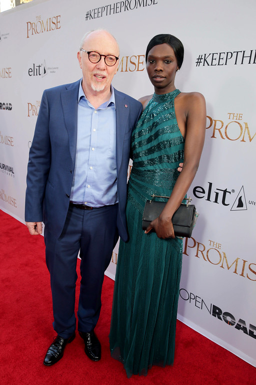 """. Writer/Director Terry George and Margaret Higgins seen at Open Road Films US Premiere of \""""The Promise\"""" at TCL Chinese Theatre on Wednesday, April 12, 2017, in Los Angeles. (Photo by Eric Charbonneau/Invision for Open Road Films/AP Images)"""